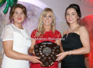 Aoife Kelly presents the Most Dedicated award to the Senior and Intermediate Camogie Team Captains Emma McMullan and Maria Lynn