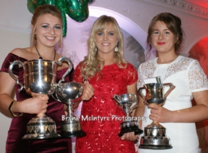 Vice Captain Laura Connolly and Captain Emma McMullan receive the trophies the Senior Camogs collected this year