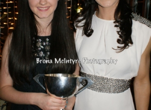 Amy Boyle receives the All Ireland Feile Cup from Special Guest Tina Hannon
