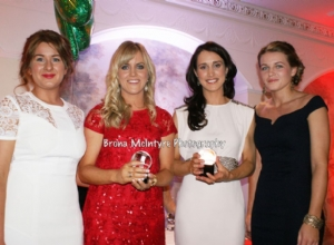 Senior Captain Emma McMullan and Senior POTY Emma Connolly presents gifts to Special Guests Aoife Kelly and Tina Hannon