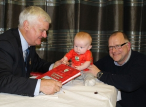 PRESIDENT WITH TOMMY MCINTYRE AND HIS GRANDSON
